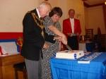 The Mayor cutting the cake