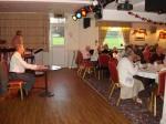 Rotarian Brian Rothwell calling the bingo numbers